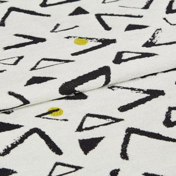 Serra Ochre fabric swatch featuring black geometric shapes on white background