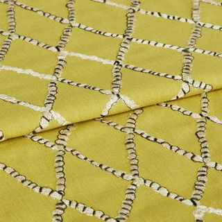 Vedra  Amarilla fabric swatch featuring hand embroidery on yellow background