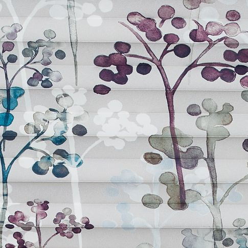 White fabric patterned with trees in purple or blue