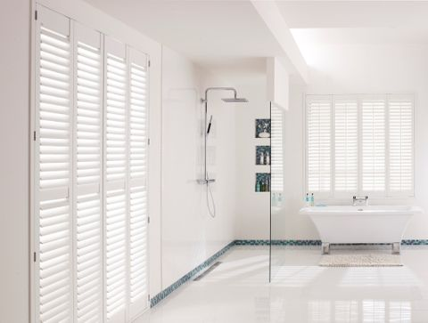 full height white shutters in bathroom
