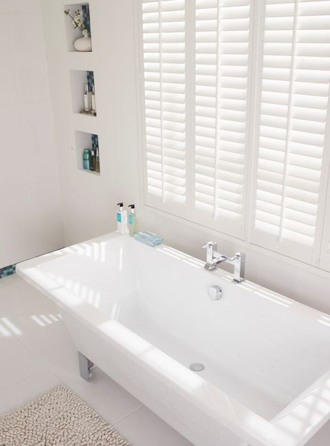 white shutters in bathroom close up