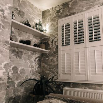 White tier on tier shutters with tilt bars in bed room