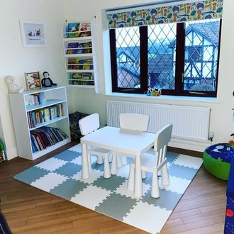 jungle book safari printed roller blinds installed on windows of children play and study room
