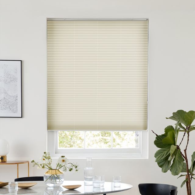 Ivory color pleated blind dressed on window