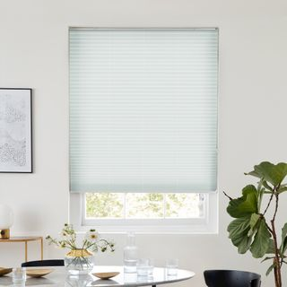White pleated blind dressed on window
