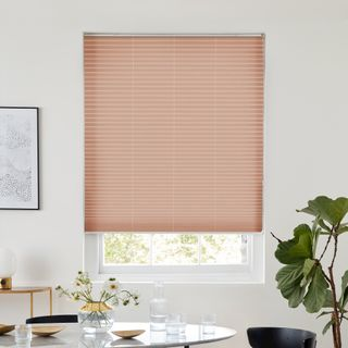 Pink blush pleated blind dressed on window