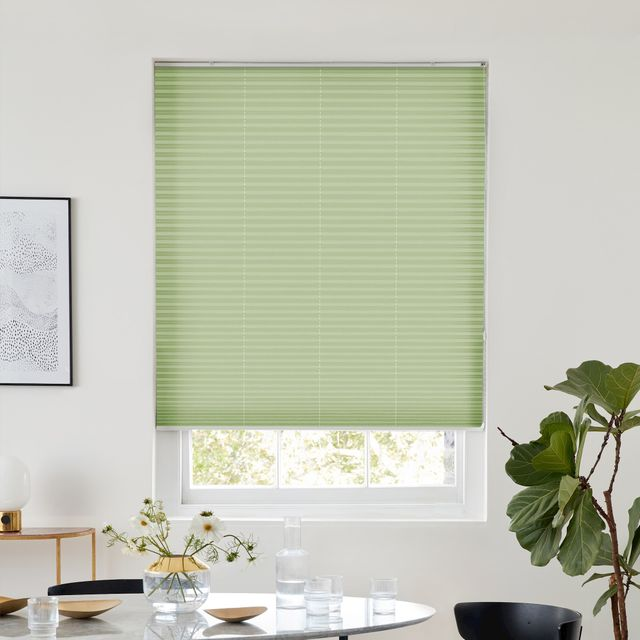 Light mint green pleated blind dressed on window