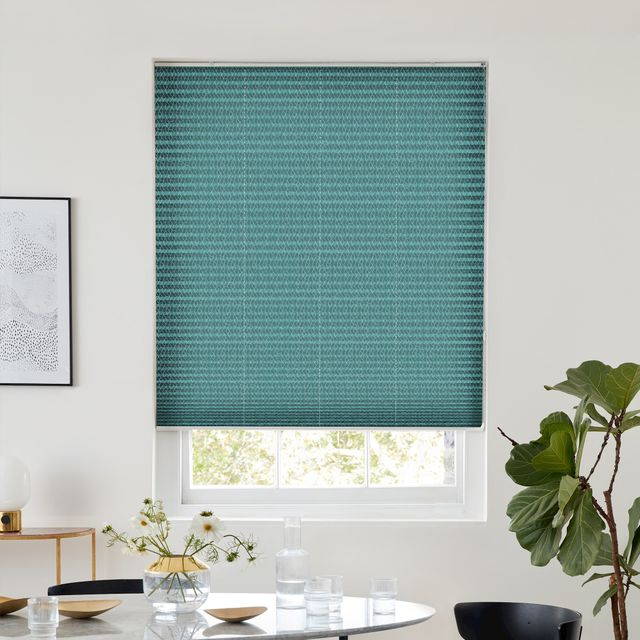 Turquoise pleated blind dressed on window