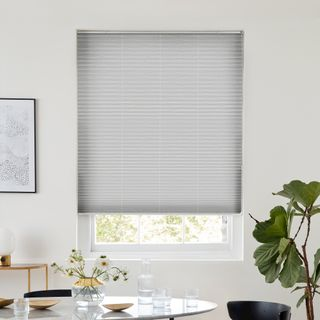 Grey pleated blind dressed on window