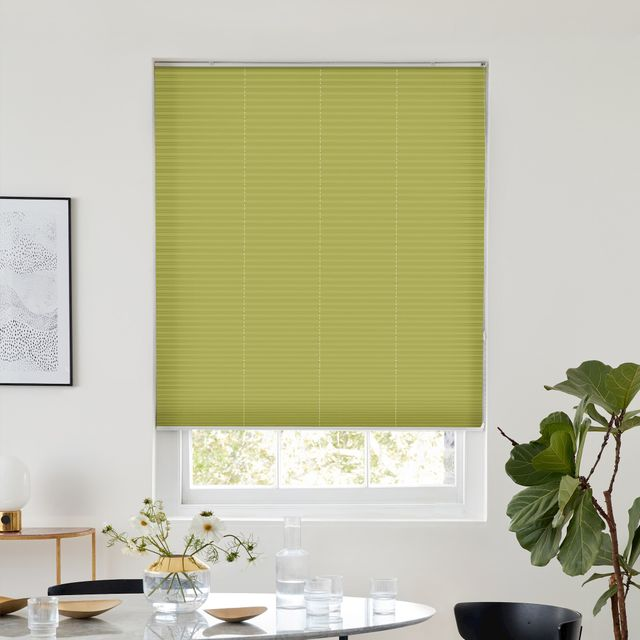 Thermashade blackout green pleated blind dressed on window