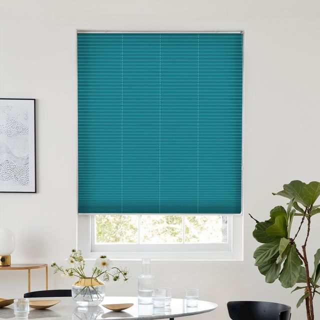 Thermashade blackout turquoise pleated blind dressed on window