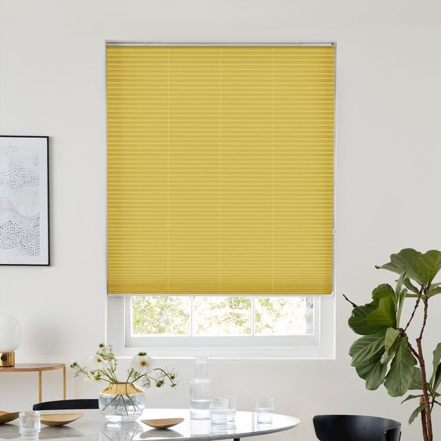 Thermashade blackout yellow pleated blind dressed on window