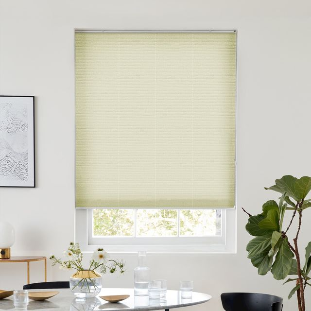 Thermashade natural pleated blind dressed on window