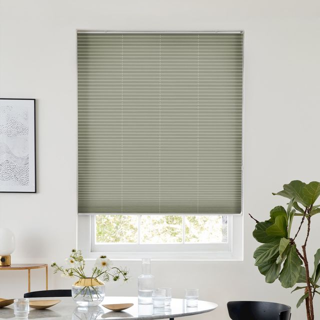 Thermashade light leaf green pleated blind dressed on window