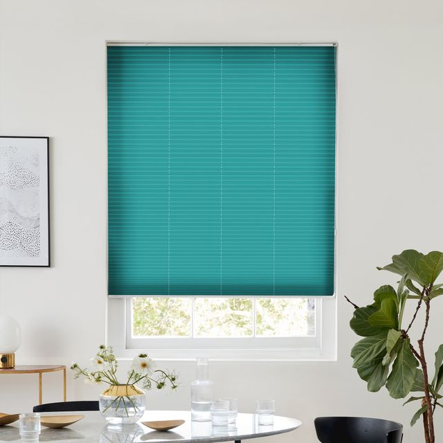 Thermashade teal texture pleated blind dressed on window