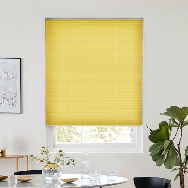 Thermashade yellow pleated blind dressed on window