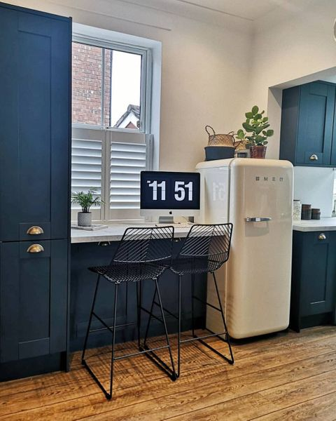 Pure White shutters in blue kitchen with bar stools