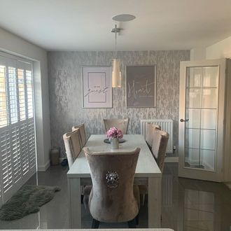 Windsor pure white shutters in dining room with dining table and velvet chairs and silver wallpaper