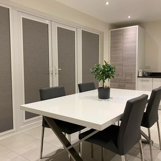 Thermashade Blackout White Pleated blinds in modern dining room