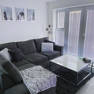 Perfect Fit venetians with marble coffee table and dark grey sofa with grey cushions