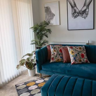 Florence white vertical blinds with teal velvet sofa and floral cushions