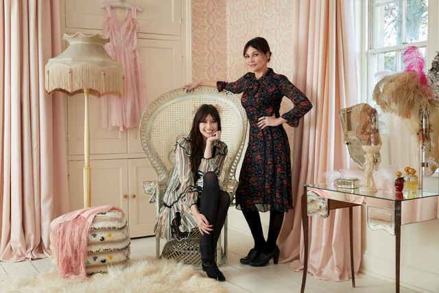 Pearl and Daisy Lowe in large living room regal chair