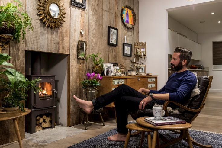 Oliver heath in cosy front living room with fire