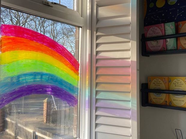 customer shutters image with vibrant rainbow painted on the window