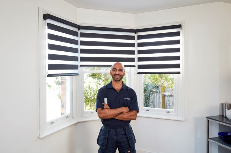 Advisor in front of blue and white striped smart blinds