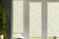 Green and white patterned Roller blinds fitted to french windows using PerfectFit frames