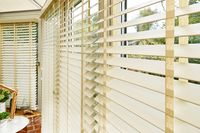 Pleated Conservatory blinds in a cream colour that have been fitted to a series of windows in a conservatory setting