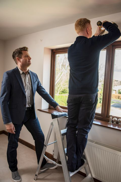 George Clarke and Advisor fitting curtains