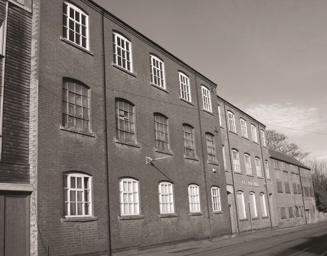 an old black and white image of the Carlton Mill on Burton Road in Nottingham