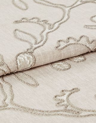 Lilac hush which is decorated in neutral colours but features a fine leaf design that is woven across the entire fabric