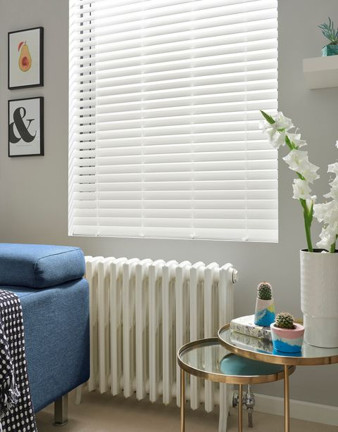 Open white blinds with cotemporary furniture