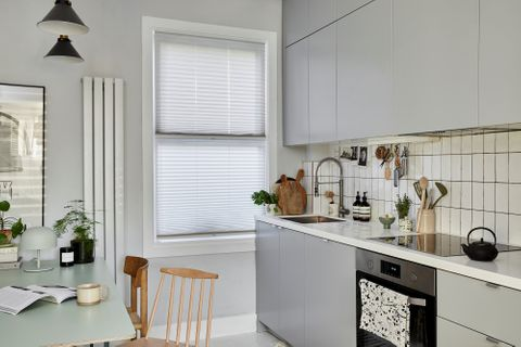 Pleated Grenoble cream blinds at kitchen window