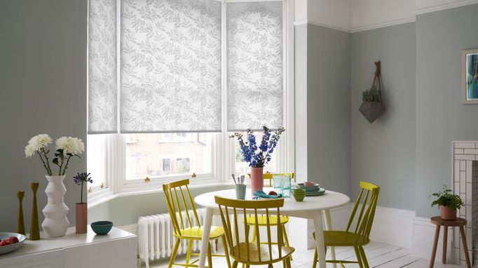 Cecile white and grey roller blind in light dining room bay bindow