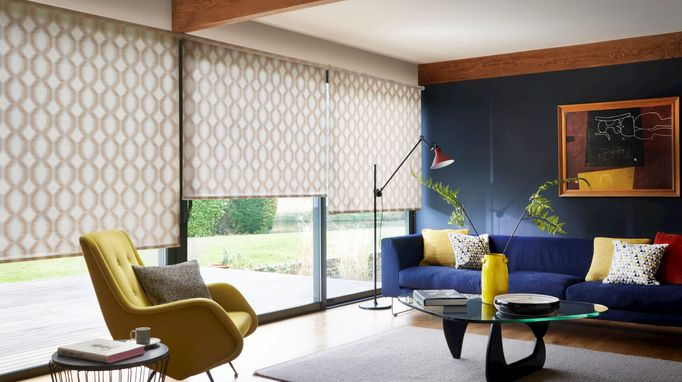 Brindle spice roller blind in wide window with navy and mustard coloured living room furniture