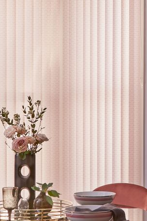 Blush pink vertical blinds in dining room with mirrored table and tray with blush pink roses in vase