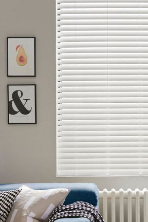 White wooden blinds with simple, modern artwork