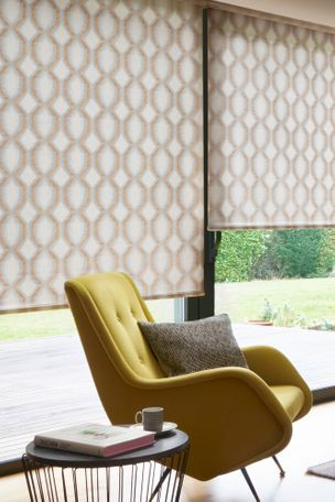 Brown and blue patterned roller blind in large living room window with relaxed mustard chair and grey cushion