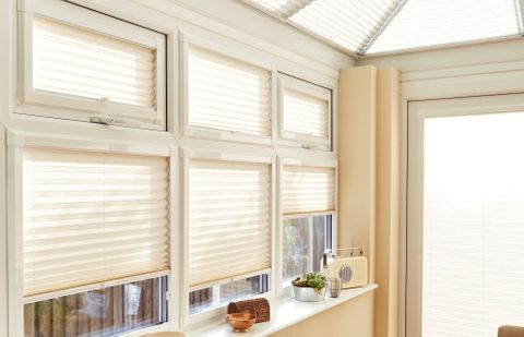 Close shot of cream coloured pleated conservatory side blinds
