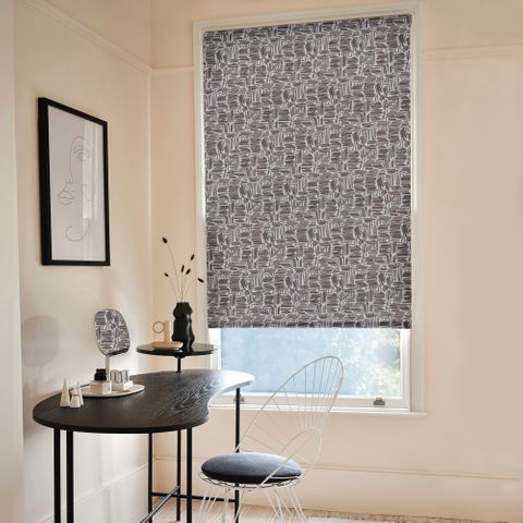 The Matchsticks Mono blind hangs in the recess in a large window. The printed Roller blind has been adjusted to allow a small amount of light into the room.