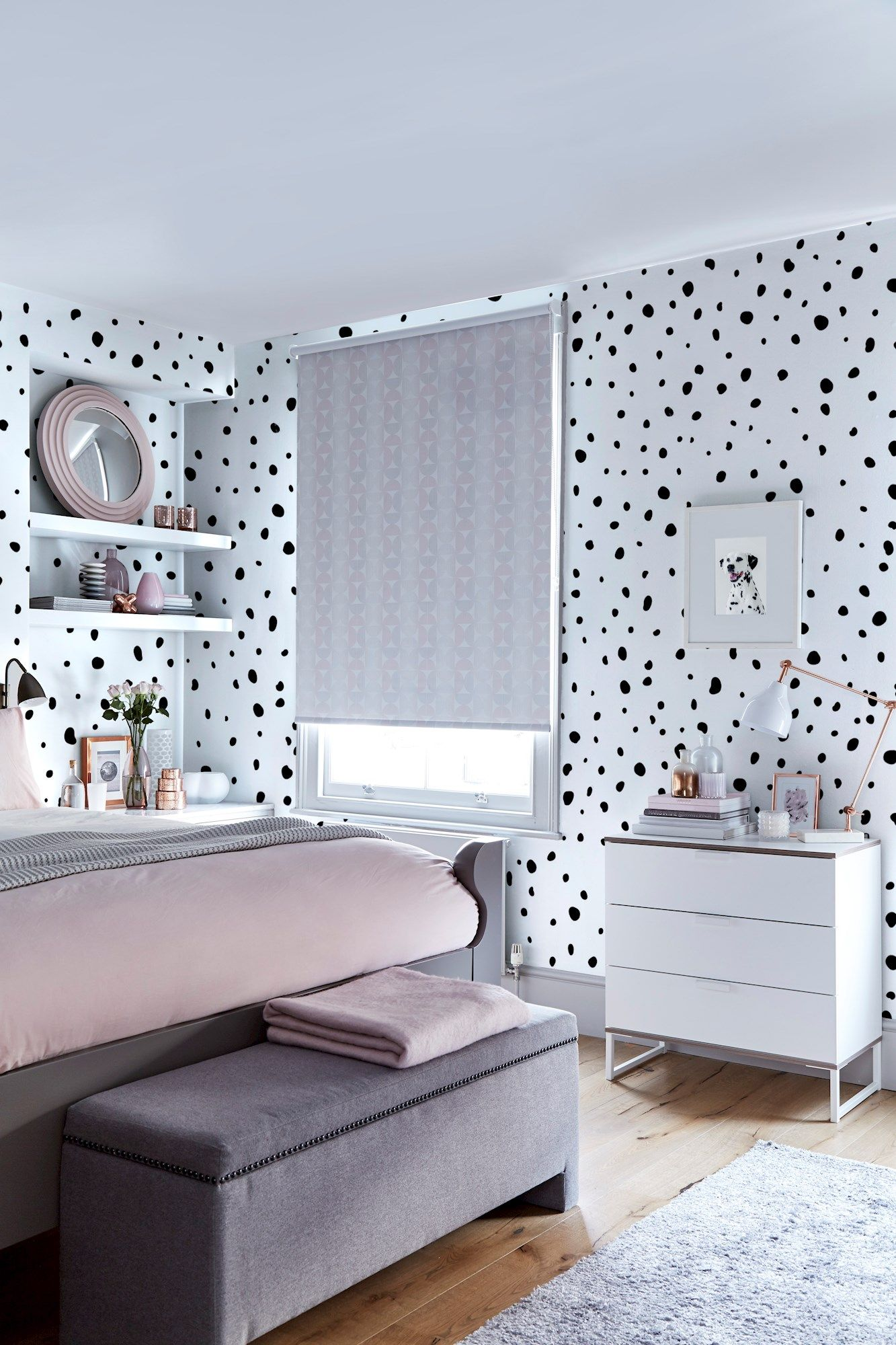 A bedroom decorated in a dalmatian style