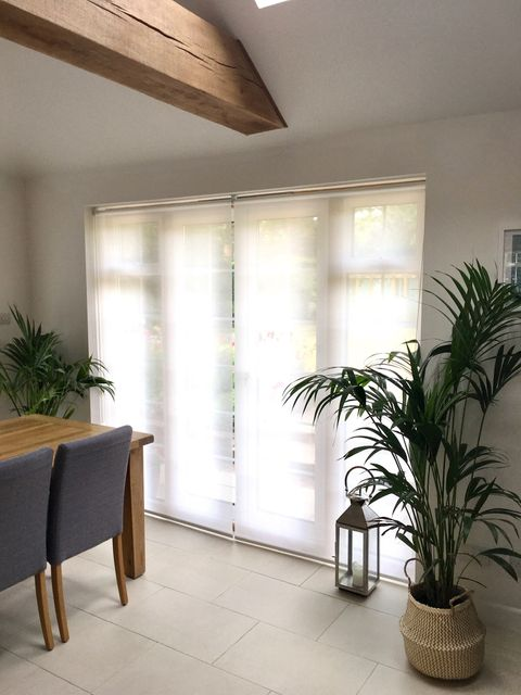 Sheer Roller blinds against patio doors