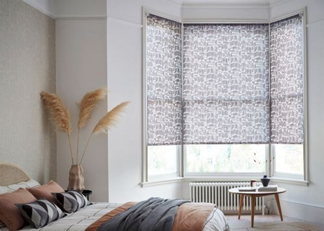 House Beautiful Matchsticks Mono Roller blind displayed in a bedroom on a bay window