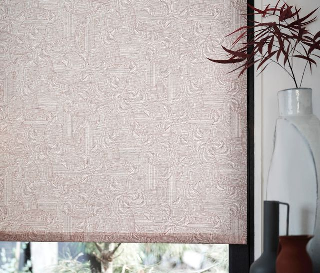 House Beautiful Breeze Russet Roller blind lifted slightly, allowing light into the room