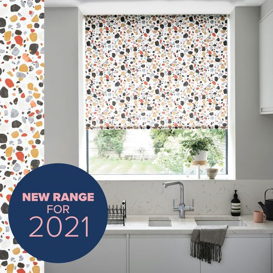 Lucca brick roller blind in modern kitchen window with 'new range for 2021' pink and blue roundel