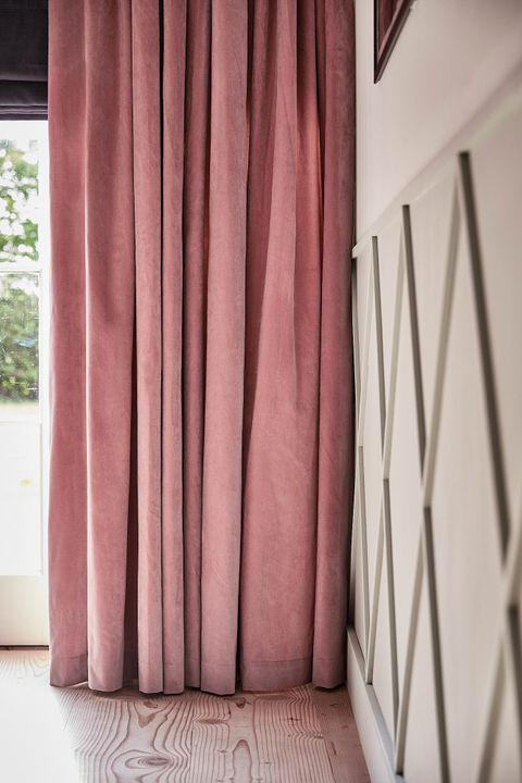 Rose pink velvet curtains in a light room