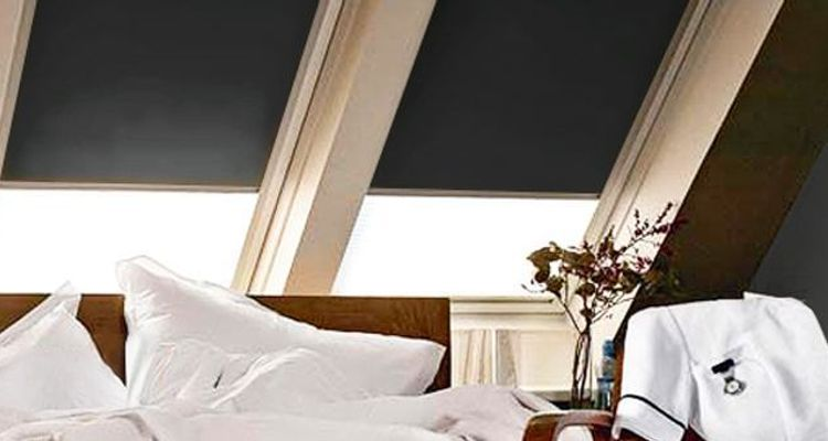 black-velux-blind-bedroom